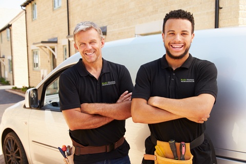 Two smiling tradesman